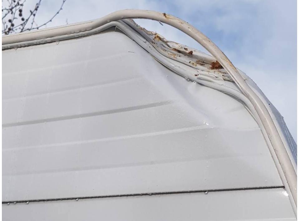 Damaged aluminium cladding and framework